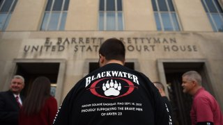 Supporters of Blackwater guards, who are to be sentenced today, gather outside the E. Barrett Prettyman US Court House in Washington, D.C., April 13, 2015.