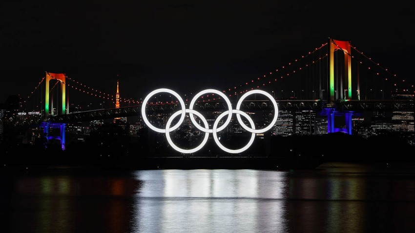 The illuminated Olympic rings, Rainbow Bridge and Tokyo Tower are seen at Tokyo Bay area, in Tokyo, Japan, Dec. 1, 2020.