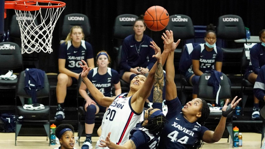 Connecticut forward Olivia Nelson-Ododa (20) and Xavier forward Ayanna Townsend (44) battle for a rebound during the first half of an NCAA college basketball game, Dec. 19, 2020, in Storrs, Conn.