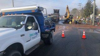 work crews dig up Route 74 in Vernon to repair a water main break