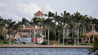 A moving truck is parked outside Mar-a-Lago in Palm Beach, Fla., on Monday, Jan. 18, 2021. President Donald Trump is expected to return to his residence on Wednesday, Jan. 20.
