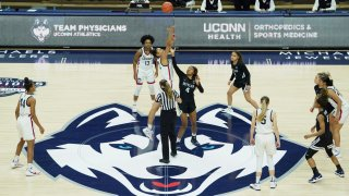 UConn tip-off against Butler to start an NCAA college basketball game Tuesday, Jan. 19, 2021, in Storrs, Connecticut.