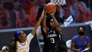 Connecticut's Christyn Williams (13) shoots with Tennessee's Jordan Walker (4) on defense during an NCAA college basketball game in Knoxville, Tennessee, Jan. 21, 2021.