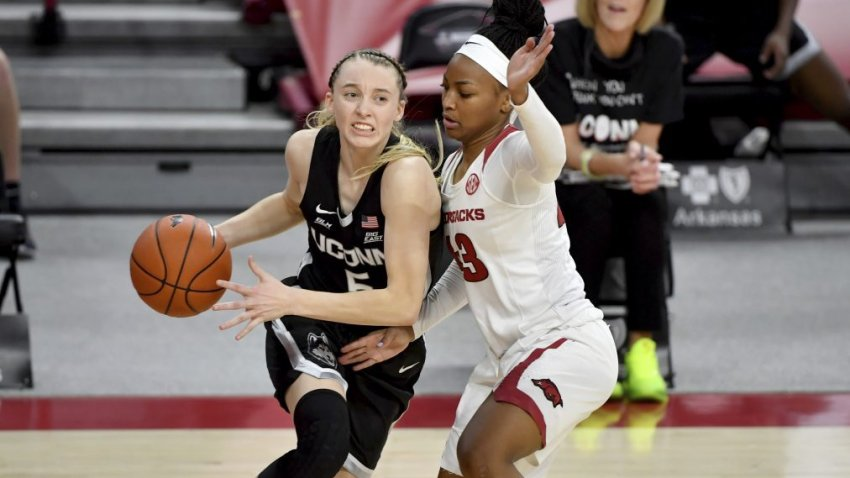 Connecticut guard Paige Bueckers (5) drives past Arkansas defender Makayla Daniels (43) during the second half of an NCAA college basketball game Thursday, Jan. 28, 2021, in Fayetteville, Ark.