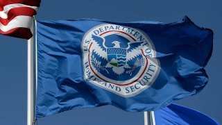 FILE - The U.S. Department of Homeland Security flag, July 31, 2014, in Karnes City, Texas.