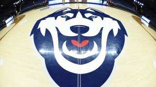 The UConn Huskies logo on the court before the game as the Buffalo Bulls take on the Rutgers Scarlet Knights on March 22, 2019 at the Gampel Pavilion in Storrs, Connecticut.