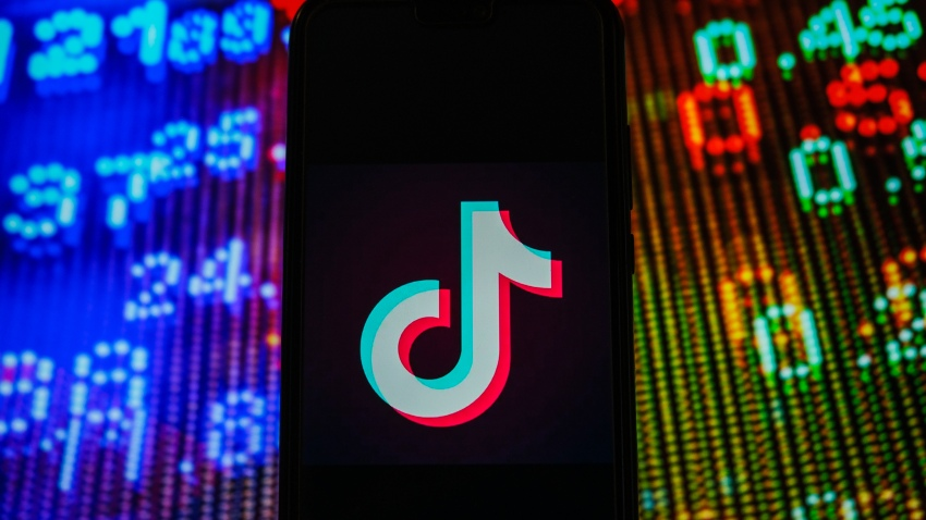 In this photo illustration, a TikTok logo seen displayed on a smartphone.