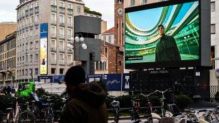 A screen displays Ermenegildo Zegna's digital Fall/Winter 2021 Men's fashion collection
