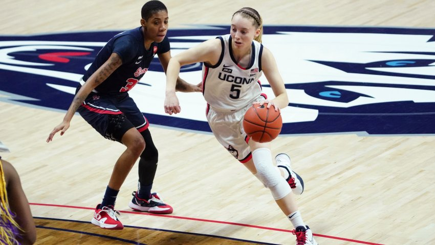 Connecticut guard Paige Bueckers (5) drives the ball against St. John's guard Kadaja Bailey (30) during the first half of an NCAA college basketball game Wednesday, Feb. 3, 2021, in Storrs, Connecticut.