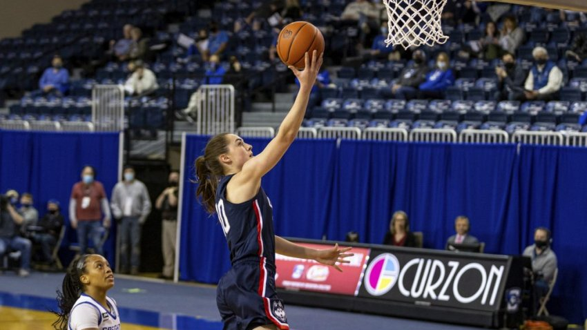Connecticut guard Nika Muhl (10) makes a layup against Creighton guard DeArica Pryor (3) in the first quarter during an NCAA college basketball game Thursday, Feb. 25, 2021, in Omaha, Neb.