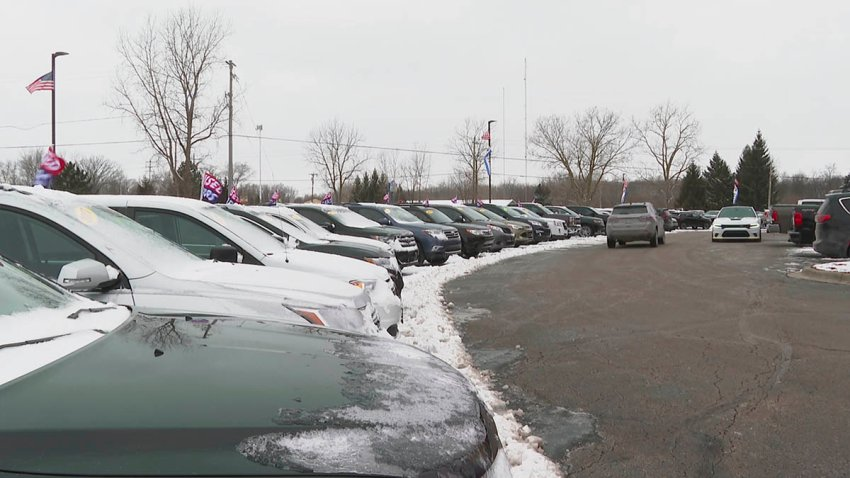 In this image made from video, cars drive through the used vehicle lot at a LaFontaine auto dealership in Fenton Township, Mich., Jan. 28, 2021. A chain reaction touched off by the coronavirus pandemic has pushed new-vehicle prices to record highs and dramatically driven up the cost of used ones.