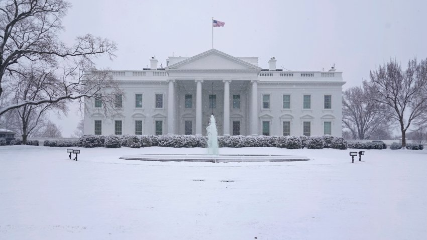 In this Jan. 31, 2021, file photo, snow falls on the North Lawn of the White House in Washington, D.C.