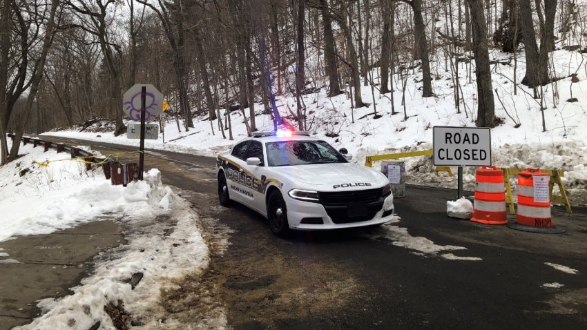 police cruiser blocks intersection near New Haven's East Rock Park
