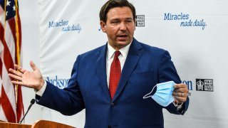 Florida Gov. Ron DeSantis speaks holding his facemask during a press conference to address the rise of coronavirus cases in the state, at Jackson Memorial Hospital in Miami, on July 13, 2020.