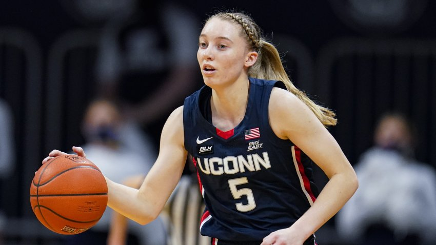In this Feb. 27, 2021, file photo, Connecticut guard Paige Bueckers (5) plays against Butler during the first quarter of an NCAA college basketball game in Indianapolis, Indiana.