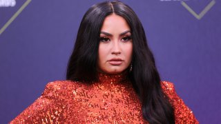 In this Nov. 15, 2020, file photo, Demi Lovato arrives at the 2020 E! People's Choice Awards held at the Barker Hangar in Santa Monica, California.