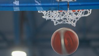 File image of a basketball dropping in the air.