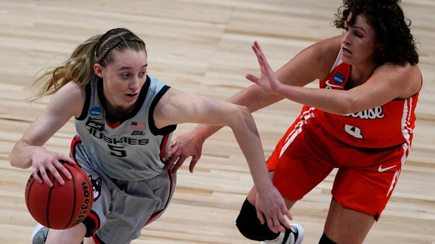 UConn guard Paige Bueckers (5) drives under pressure from Syracuse guard Tiana Mangakahia (4) during the first half of a college basketball game in the second round of the women's NCAA tournament at the Alamodome in San Antonio, Tuesday, March 23, 2021.