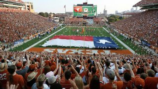 """Fans sing """"The Eyes of Texas"""" before the start of the NCAA football game between the Texas Longhorns and the Rice Owls on Sept. 3, 2011, at Darrell K. Royal-Texas Memorial Stadium in Austin, Texas."""