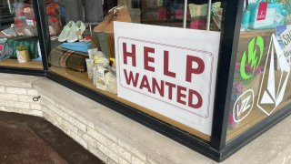 A help wanted sign at a Cape Cod business