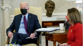 President Joe Biden, speaks with House Speaker Nancy Pelosi in the Oval Office of the White House, Friday, Feb. 5, 2021, in Washington.