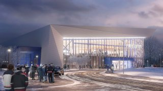 This artist rendering provided by the University of Connecticut, shows the proposed UConn Hockey Arena, approved by the school's Board of Trustees, Wednesday, April 28, 2021. The $70-million plan is for a 2,500-seat hockey rink on campus in Storrs, Conn., a facility that will be smaller and much more expensive than originally anticipated.