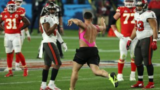 TAMPA, FLORIDA - FEBRUARY 07: Yuri Andrade trespasses on the field during the fourth quarter in Super Bowl LV between the Tampa Bay Buccaneers and the Kansas City Chiefs at Raymond James Stadium on February 07, 2021 in Tampa, Florida.