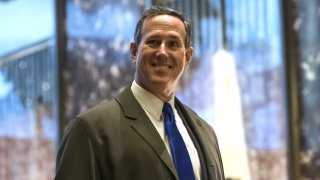 """Rick Santorum, former senator from Pennsylvania, arrives at Trump Tower in New York, U.S., on Monday, Dec. 12, 2016. Senate Majority Leader Mitch McConnell said he had the """"highest confidence"""" in the intelligence community, in sharp contrast to President-elect Donald Trump's attack on the CIA after reports it found that the Russian government tried to help him win the presidency."""