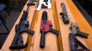 """FILE - This Nov. 27, 2019, file photo shows """"ghost guns"""" on display at the headquarters of the San Francisco Police Department in San Francisco. A federal appeals court in San Francisco has ruled that plans for 3D-printed, self-assembled """"ghost guns"""" can be posted online without U.S. State Department approval. The San Francisco Chronicle says the 2-1 decision was made Tuesday, April 27, 2021, by the 9th U.S. District Court of Appeals."""