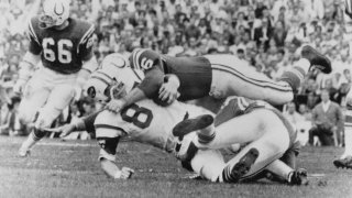This Jan. 12, 1969 file photo shows New York Jets Pete Lammons (87) getting tackled during the Super Bowl in Miami