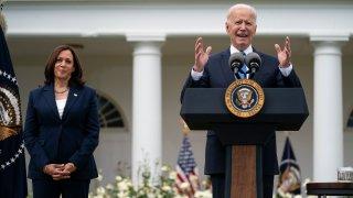 Vice President Kamala Harris listens as President Joe Biden speaks on updated guidance on mask mandates, in the Rose Garden of the White House, Thursday, May 13, 2021, in Washington.