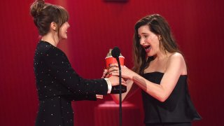 """(L-R) Elizabeth Olsen and Kathryn Hahn accept the Best Fight award for """"WandaVision"""" onstage during the 2021 MTV Movie & TV Awards at the Hollywood Palladium on May 16, 2021, in Los Angeles, California."""