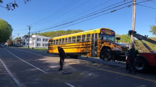 School bus being towed after a crash in Seymour