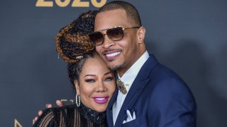 """In this Feb. 22, 2020, file photo, Tameka """"Tiny"""" Cottle and T.I. attend the 51st NAACP Image Awards at the Pasadena Civic Auditorium in Pasadena, California."""