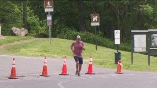 Person running between orange cones