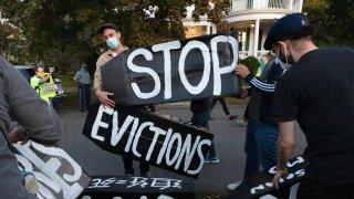 housing activists erect a sign in Swampscott, Mass.