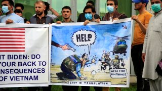 Former Afghan interpreters hold banners during a protest against the U.S. government and NATO in Kabul, Afghanistan