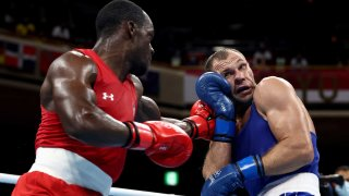 Troy Isley of Team USA faces Vitali Bandarenka of Belarus