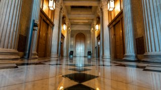 This June 30, 2021, photo shows the halls of the Capitol outside the Senate in Washington