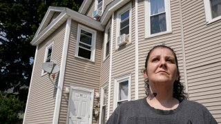 Roxanne Schaefer, of West Warwick, R.I., stands for a photograph outside of her apartment building