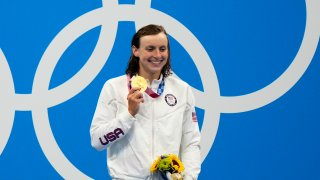 Katie Ledecky, of United States, poses after winning the gold medal in the women's 800-meter freestyle final at the 2020 Summer Olympics, Saturday, July 31, 2021, in Tokyo, Japan.
