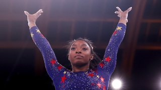 USA's Simone Biles competes in the artistic gymnastics balance beam event of the women's qualification during the Tokyo 2020 Olympic Games at the Ariake Gymnastics Centre in Tokyo on July 25, 2021.