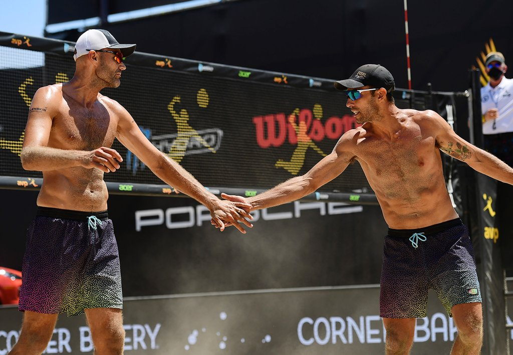 Phil Dalhausser and Nick Lucena celebrate in the finals against Trevor Crabb (not pictured) and Tri Bourne (not pictured) during the Porsche Cup on Aug. 2, 2020, in Long Beach, California.