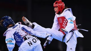 BAKU, AZERBAIJAN - JUNE 19: Tina Skaar of Norway (blue) and Reshmie Oogink of the Netherlands (red) compete in the Women's +67kg Taekwondo Preliminary Round during day seven of the Baku 2015 European Games at the Crystal Hall on June 19, 2015 in Baku, Azerbaijan.