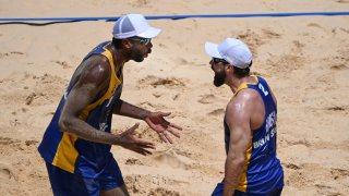 Bruno Schmidt's bid for consecutive beach volleyball golds started with a win