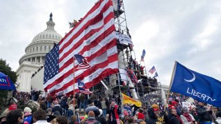 Supporters of Donald Trump gather outside the Capitol building in Washington D.C., on January 06, 2021.