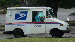 U.S. Postal Service carrier John Graham drives a 28-year-old delivery truck
