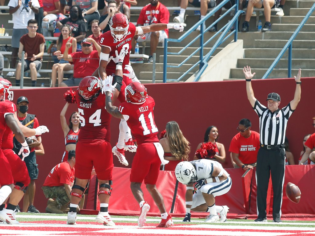 Fresno State wide receiver Ty Jones (8) celebrates a touchdown against Connecticut during the first half of an NCAA college football game in Fresno, Calif., Saturday, Aug. 28, 2021.