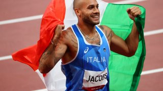 Lamont Marcell Jacobs of Team Italy celebrates after winning gold in the Men's 100m Final