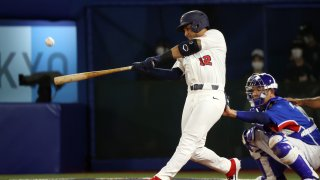 Jamie Westbrook #12 of Team United States hits a solo home run in the fourth inning against Team Republic of Korea during the semifinals of the men's baseball on day thirteen of the Tokyo 2020 Olympic Games at Yokohama Baseball Stadium on August 05, 2021 in Yokohama, Japan.